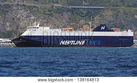 SALERNO ITALY - JUNE 28: Neptune Lines in Salerno on JUNE 28 2014. Neptune Thelisis Big Car Carrier RoRo Ship Leaving Port in Salerno Italy.