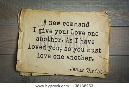 Jesus quote on old paper background. A new command I give you: Love one another. As I have loved you, so you must love one another.
