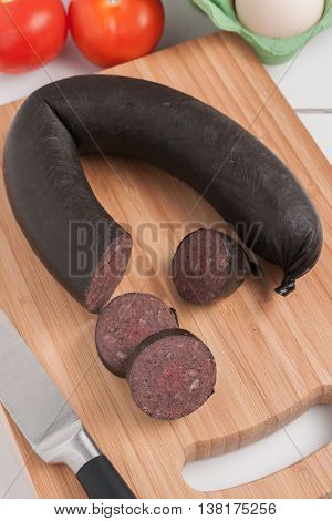 British black pudding or blood sausage sliced for breakfast