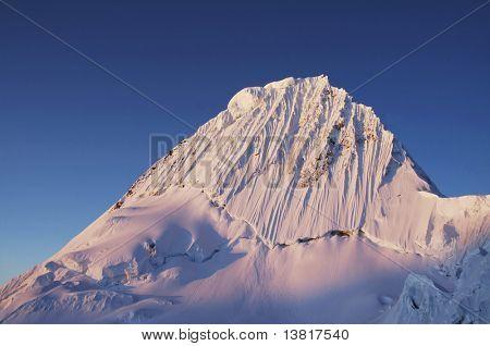 Alpamayo peak on sunset in Cordilleras