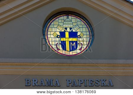 Mount St. Anna Poland - July 7 2016: Arms Pope St. John Paul II on the wall of the Basilica of St. Anne of Mount St. Anna Poland. Papal gate.