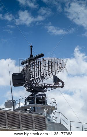 phased array surface detection and tracking radar early warning system mounted on gray frigate