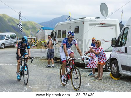 Col de la Croix de Fer France - 25 July 2015:The cyclists Benoit Vaugrenard of FDJ Team and Leopold Konig of Team Sky climbing to the Col de la Croix de Fer in Alps during the stage 20 of Le Tour de France 2015.