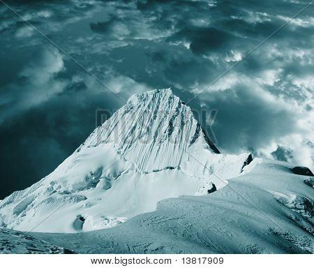 Beautiful peak Alpamayo in storm