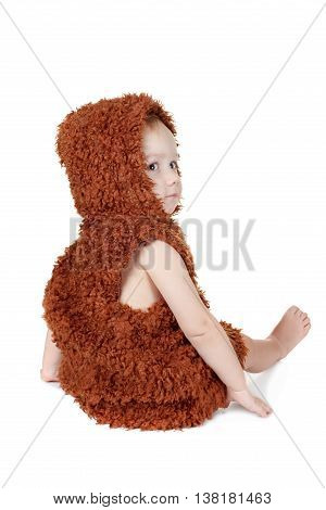 Little funny Neanderthal boy portrait back in a suit. Humorous concept ancient caveman. Isolated on white.