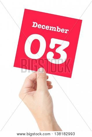 December 3 written on a card held by a hand