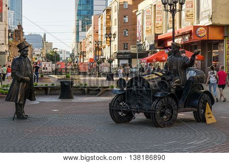Yekaterinburg, Russia - July 10, 2016: Bronze sculpture of a banker and his driver in the city of Yekaterinburg in the street Weiner.