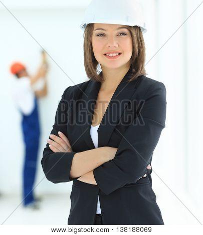 Woman construction worker with hard hat with staff