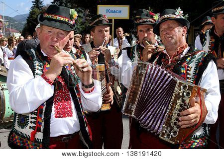 Rakhiv Ukraine - September 8. 2013: Hutsul musicians in folk costumes performing on the street during the festival-fair