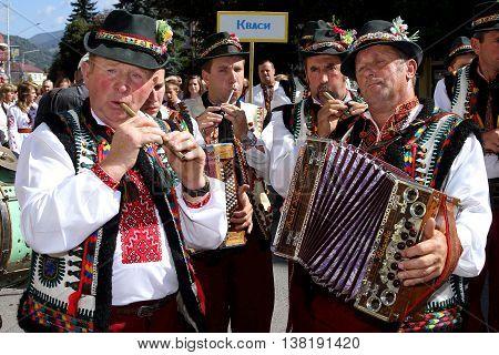 Rakhiv Ukraine - September 8. 2013: Hutsul musicians in folk costumes performing on the street during the festival-fair