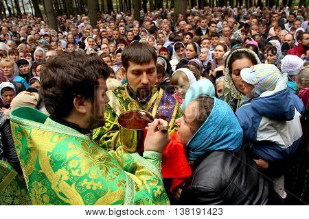 Iza-Karputlash Ukraine - October 21. 2014: Priests conduct the communion rite during the church service on the occasion of the second Maramarosh-Sigot trial in the Ortodox in St. Nicholas Monastery.