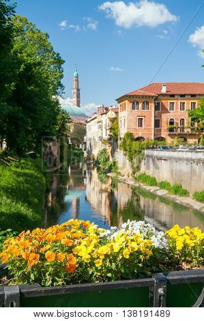 Flowered balcony of Monte Furo in Vicenza Italy with a view of retrone river and the clock tower in the distance poster