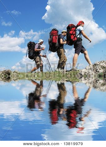 Backpackers group going  in mountain