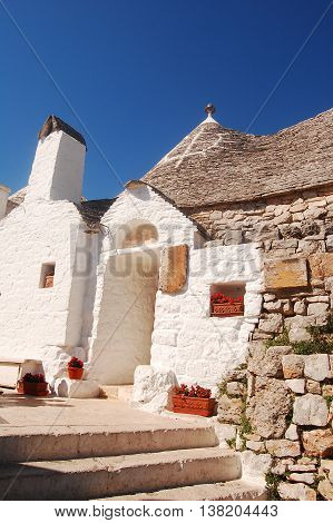 A characteristic flowery corner of the city of Alberobello - Apulia - Italy