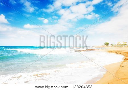 Aegan sea and Malia beach, Crete Greece, toned