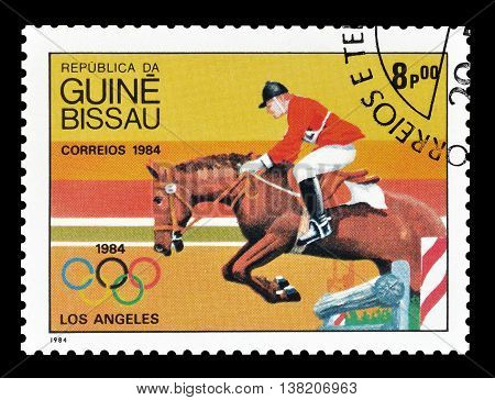 GUINEA BISSAU - CIRCA 1984 : Cancelled postage stamp printed by Guinea Bissau, that shows Horse jumping.