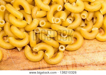 Dry Pasta Elbow Macaroni Closeup Raw Uncooked Wood Cutting Board