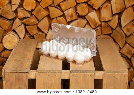 Dozen of white eggs on brown wooden stand