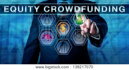 Male broker-dealer is pressing EQUITY CROWDFUNDING on an interactive touch screen. Business concept for the practice of offering private company securities via the internet to attract investment.