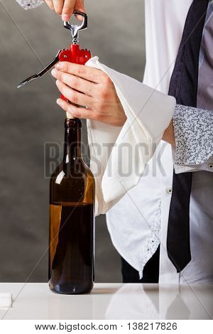 Waiter Opens Wine Bottle.