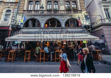 Sarajevo Bosnia and Herzegovina - August 23 2015. People walks in front of restaurant at Zelenih Beretki Street