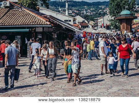 Sarajevo Bosnia and Herzegovina - August 23 2015. Tourists and local residents walks around Sebilj fountain located at main square of Bascarsija area in Sarajevo