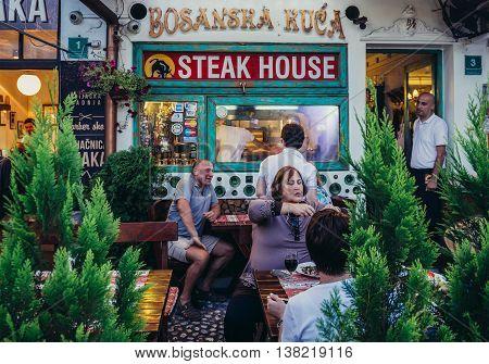 Sarajevo Bosnia and Herzegovina - August 23 2015. People sits in small restaurant at Bascarsija area in Sarajevo