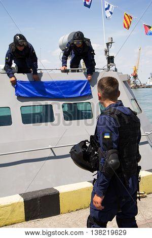 Odesa, Ukraine - July 03, 2016: Military sailors near new warship 'Akerman'. Celebration of Ukrainian NAVY forces day