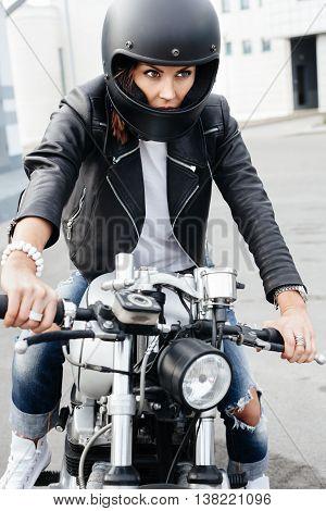 Biker Girl In Helmet On Custom Motorcycle