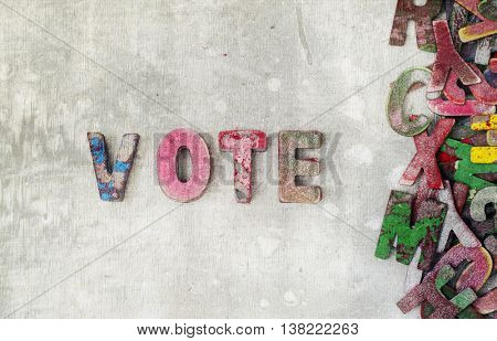 the word vote made with old wooden letters