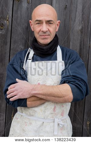 Portrait Of Man In Thick Clothing And White Apron