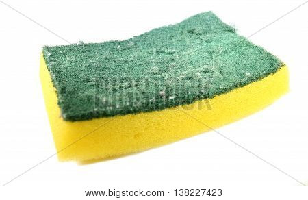 Used yellow sponge with dark green scrubber - isolated