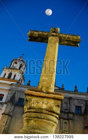 Stone Cross at the entrance to San Juan Bautista Parish Coyoacan. Built between 1520 and 1552 it is one of oldest churches in Mexico City