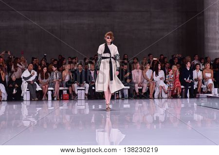 SYDNEY AUSTRALIA - 15 May 2016: Toni Maticevski female evening and red carpet dresses clothing collection fashion show runway at Mercedes Benz Fashion Week in The Cutaway Barangaroo Reserve Australia