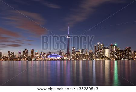 The Toronto skyline with towers  during dusk.