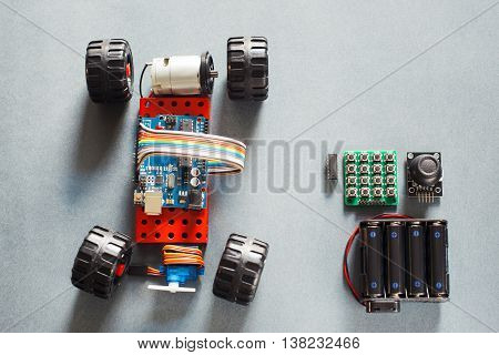 Handmade rc car model, construction on electronic. Little homemade truck for rally with remote control, prototype of automobile toy for adults. Modern technologies in playthings.