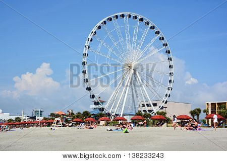 MYRTLE BEACH SOUTH CAROLINA JUNE 29 2016: SkyWheel when it opened on 20 May 2011 it was the second-tallest extant Ferris wheel in North America, after the Texas Star in Dallas