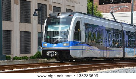 CHARLOTTE NC USA 06 24 2016: LYNX Blue Line of The Charlotte Area Transit System, commonly referred to as CATS, is the public transit system. It operates bus and rail of Charlotte metropolitan area.