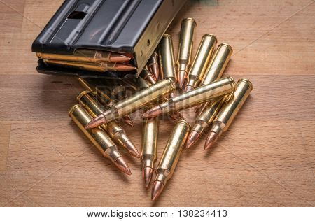 Ammunition in Magazine .223/556 on Wood Surface