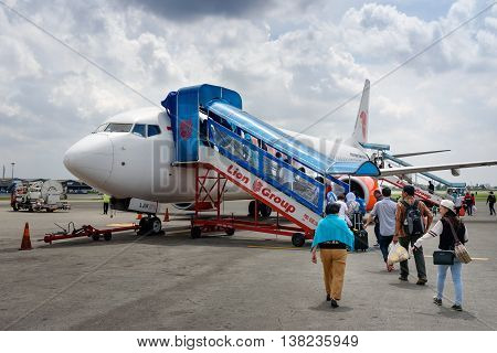 Passengers Entering An Lion Air Airplane At Soekarno-hatta International Airport