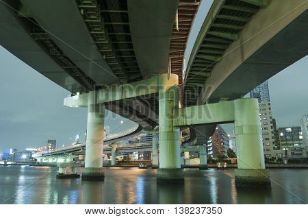 huge highway structure over Sumida river in Tokyo by night