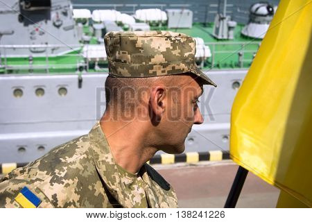 Odesa, Ukraine - July 03, 2016: Ukrainian Military officer in the Port of Odesa, guarding during celebration NAVY forces day.