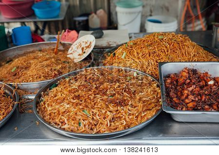 Kway teow fried noodles at the Kimberly Street Food Night Market George Town Penang Malaysia.