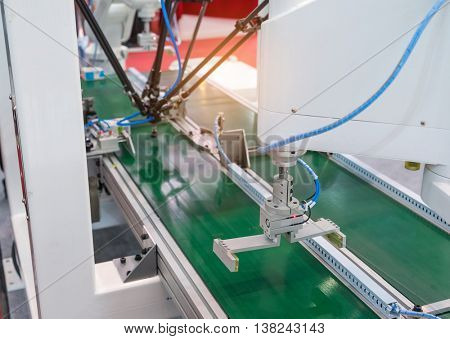 Industrial robot working in factory,Conveyor Tracking Controler of robotic hand.