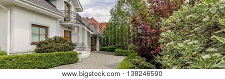 Impressive Suburban House Immersed In Flourishing Garden