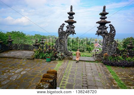 Traditional entrance stone gate in Pura Besakih Balinese temple and famous landmark on Bali island Indonesia
