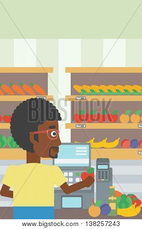 An african-american young male cashier standing at the checkout in supermarket. Male cashier working at checkout in supermarket. Vector flat design illustration. Vertical layout.