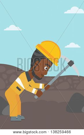 An african-american miner working with a pickaxe. Mine worker in hard hat. Miner at the coal mine. Vector flat design illustration. Vertical layout.