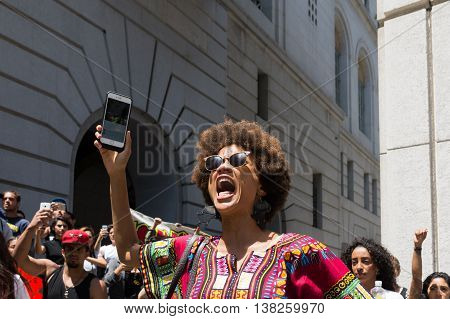 Black Lives Matter Protestor Shouting During March On City Hall