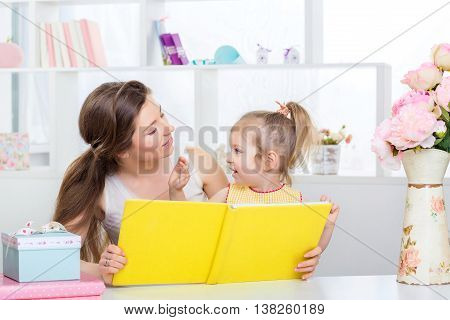 Mom And Daughter Reading Together